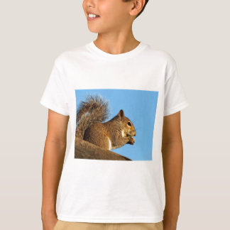 Squirrel Eating in a Tree Against Clear Blue Sky T-Shirt