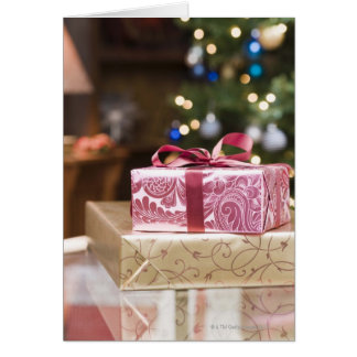 Stack of holiday gifts greeting card