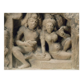 Stone carving of lovers enjoying a dance performan postcard