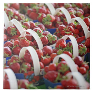 Strawberries at a market stall large square tile