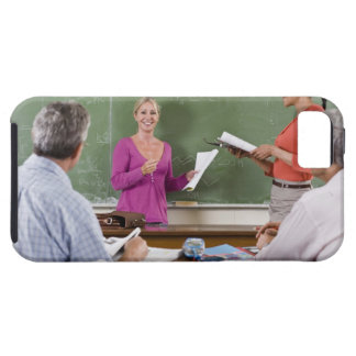Student talking to class and standing by teacher iPhone 5 covers