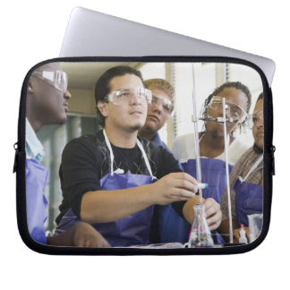 Students performing experiment in chemistry lab laptop sleeve