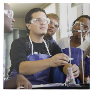 Students performing experiment in chemistry lab tile