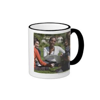 Students with professor mug