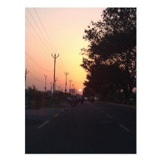 Sun on the road at sunset post cards