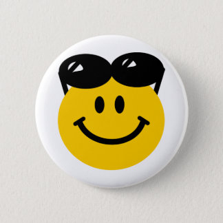 Sunglasses perched on top of head smiley face 6 cm round badge