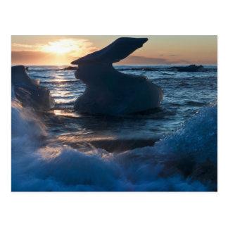 Sunrise and iceberg formation on the beach postcard