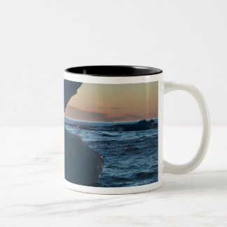Sunrise and iceberg formation on the beach Two-Tone coffee mug