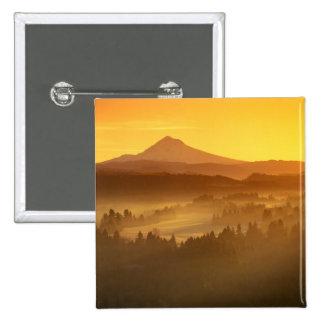 Sunrise orange colors the fog in the valley in 15 cm square badge