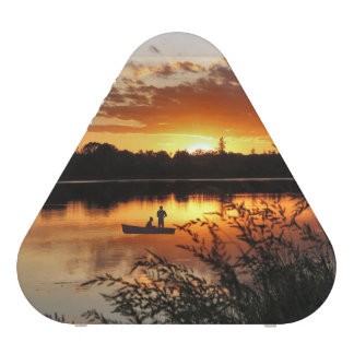 Sunset Over Water With Boat Speaker