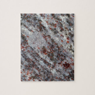 Surface of a gneiss rock with garnets jigsaw puzzle