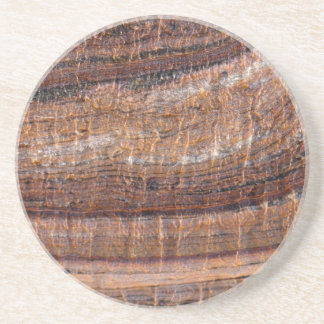 Surface of carbonate rock with weathering traces coaster