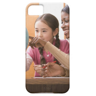 Teacher and student looking at globe iPhone 5 cover