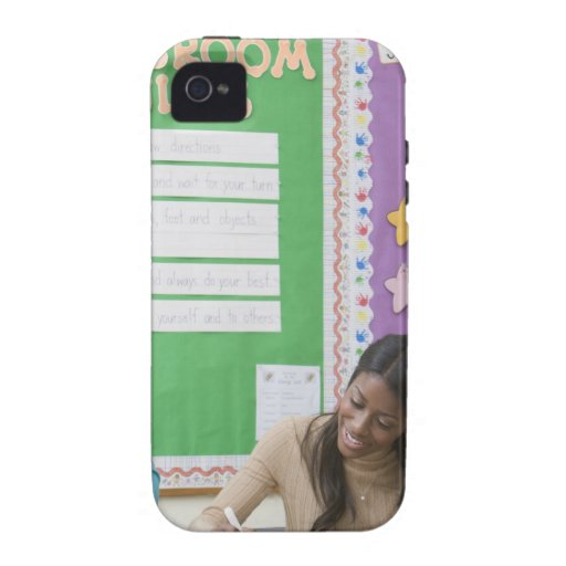 Teacher grading girls paper in classroom iPhone 4/4S cover