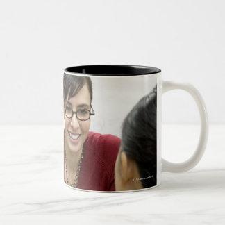 Teacher talking to student in laboratory Two-Tone coffee mug