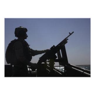 Technician manning an M240 machine gun in Iraq Photo