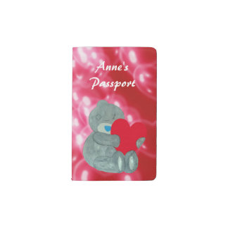 Teddy bear holding a red heart pocket moleskine notebook