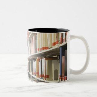 Teenage student in library Two-Tone coffee mug