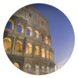 the Colosseum ampitheatre illuminated at night Plate