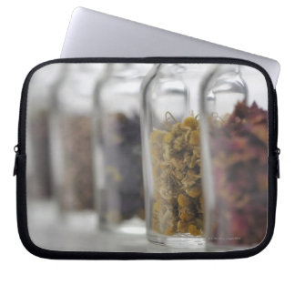 The herbs which a glass bottle contains laptop sleeve