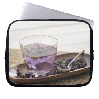 The mallow herb tea which a glass cup contains, laptop sleeve