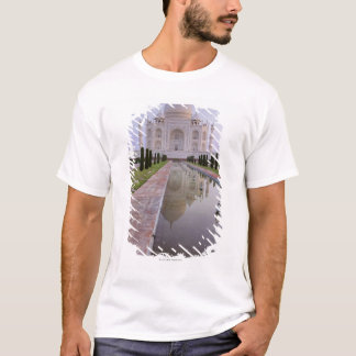The Taj Mahal perfectly reflected in the still T-Shirt