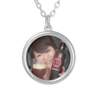 The tsu it comes, - round pendant necklace