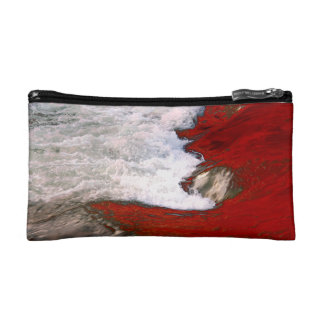 The white foam stops to the red lava river makeup bag