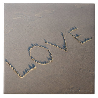 The word Love spelled out in the sand. Ceramic Tile