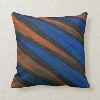 This is a Throw Pillow Black, Blue and Orange.