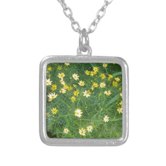 Tiny yellow flowers with greenery silver plated necklace