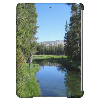 Tree-Lined River Meadow with Mountain Vista Photo