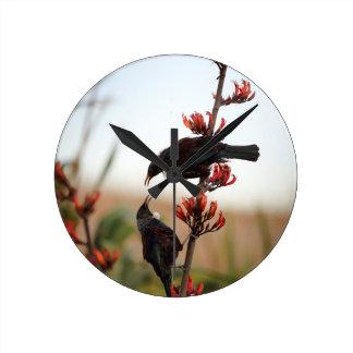 Tui birds on New Zealand flax Round Clock