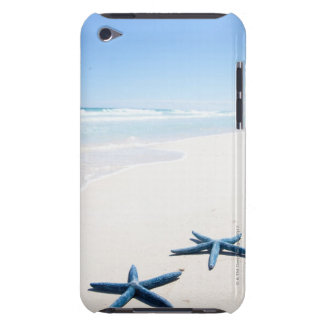 Two blue starfish at water's edge on tropical iPod Case-Mate case