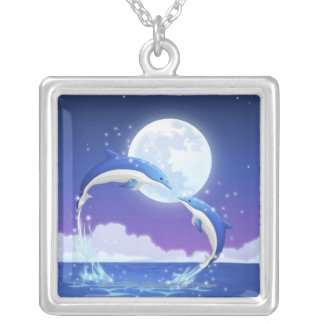 Two bottle-nosed dolphins jumping out of water silver plated necklace