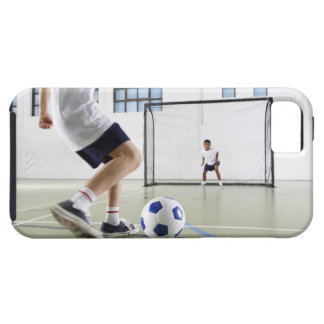 Two boys, aged 8-9, playing soccer in a school iPhone 5 cover