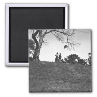 Two boys flying kite on hill B&W Magnet