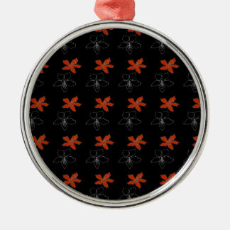 Two flowers on black christmas ornament
