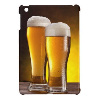 Two glasses of beers on a wooden table iPad mini case