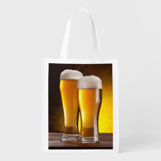 Two glasses of beers on a wooden table reusable grocery bag