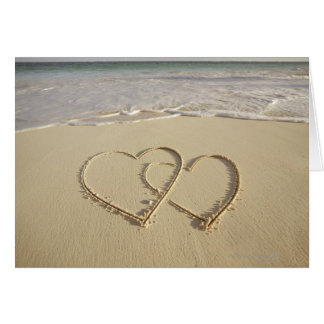 Two overlying hearts drawn on the beach cards