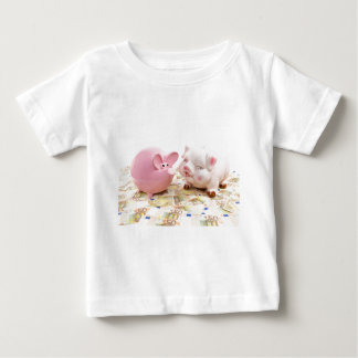Two pink piggy banks on spread euro notes baby T-Shirt