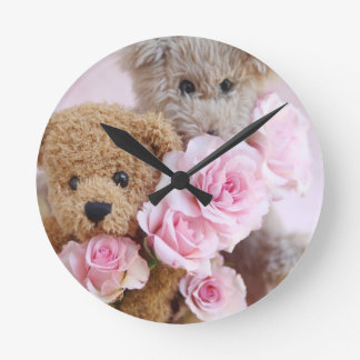 two teddy bears holding roses clock