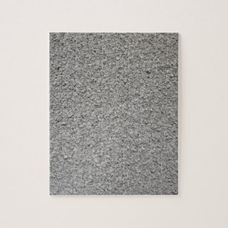 Uneven surface of the gray cement jigsaw puzzle