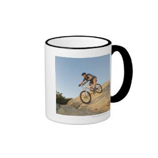 USA, California, Laguna Beach, Man cycling down Mug