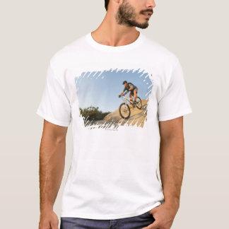 USA, California, Laguna Beach, Man cycling down T-Shirt