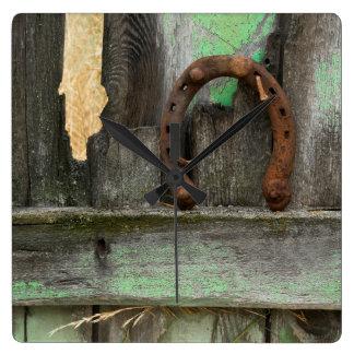 USA, Montana. Rusty horseshoe on old fence Square Wall Clock