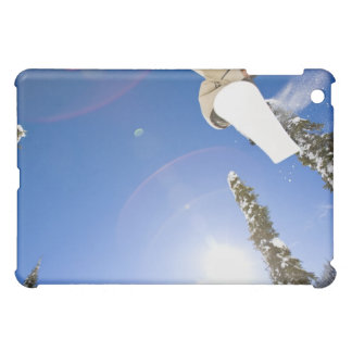 USA, Montana, Whitefish, Young man snowboarding Cover For The iPad Mini