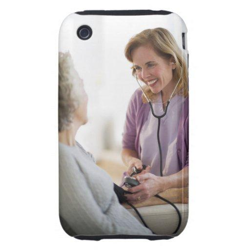 USA, New Jersey, Jersey City, Female nurse Tough iPhone 3 Covers