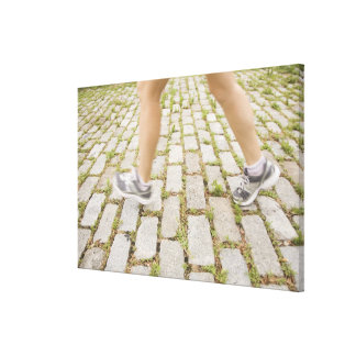 USA, New York City, Blurred legs of woman Canvas Print